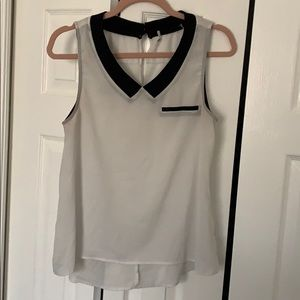 Tops - Chic office sleeveless top with black trim collar